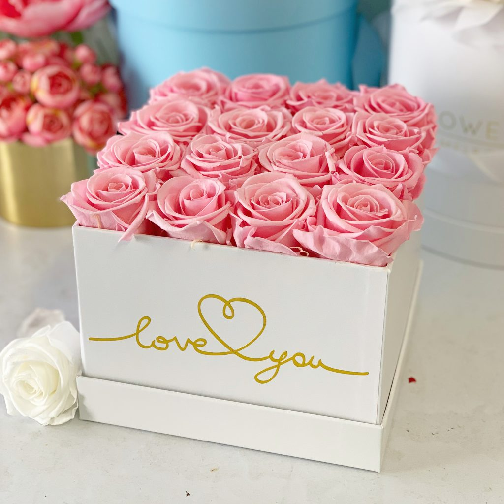 Square flower box with pink roses